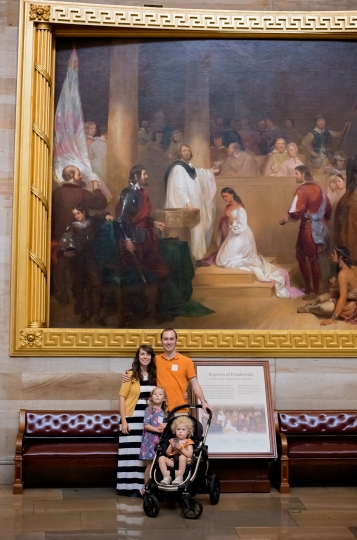 Family picture next to Pocahontas painting