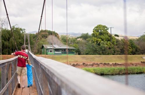 Carefully walking across the bridge